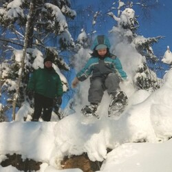 Snowshoe hiking in the wilderness of Karelia