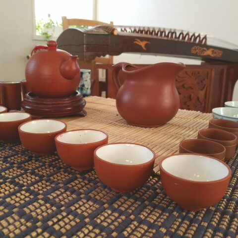 Tea ceremony with ancient Chinese instrument