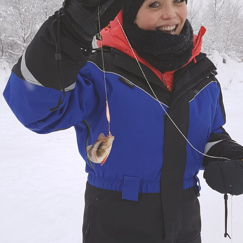 Traditional Finnish fishing trip (ice-fishing in winter time)