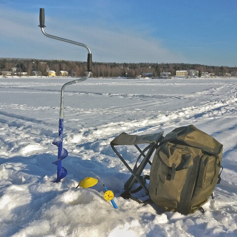 Arctic ice fishing with a local